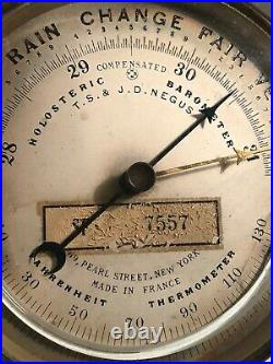 ANTIQUE T. S. &J. D. NEGUS ROUND BRASS HOLOSTERIC BAROMETER With CURVED THERMOMETER