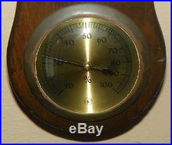 Barometer with Clock and Thermometer. Dark Walnut-Colored Wood. C. 1920-1930